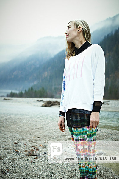 Hippy woman standing in mountains