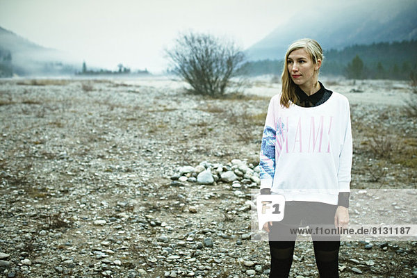Woman standing in remote setting