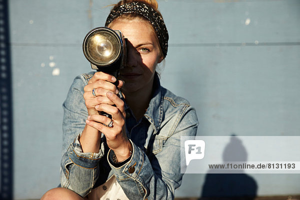 Woman using old video camera
