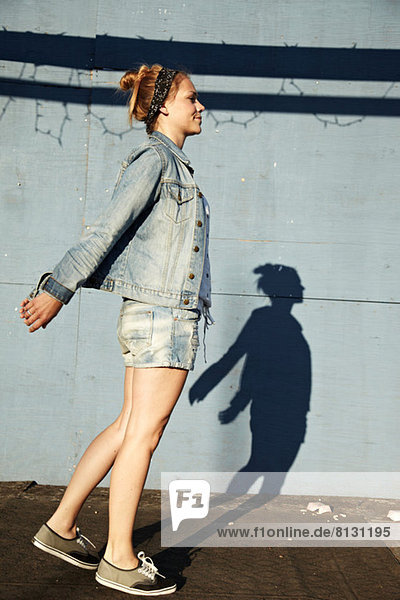 Side view of woman and shadow