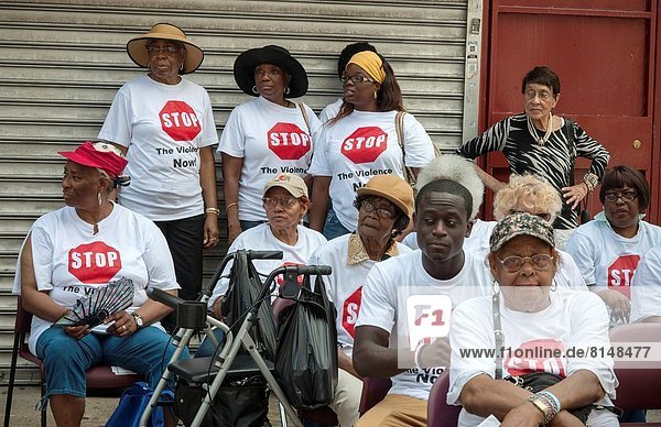 Residents of the Grant and Manhattanville housing projects in Harlem in New York rally against gun violence in their projects. Rival gangs in the projects have disruptive feuds with shootings which recently claimed the life of an innocent 18 year old girl.