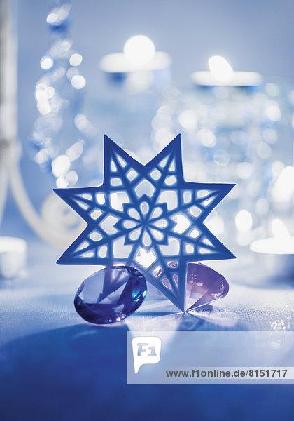 Weihnachtliche Dekoration mit Stern