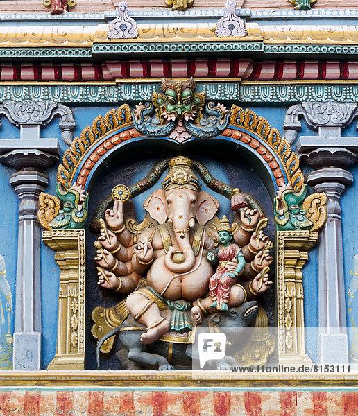 Hindu god Ganesha or Ganpati  the elephant-headed god in a representation with ten arms on a temple wall  Meenakshi Amman Temple or Sri Meenakshi Sundareswarar Temple