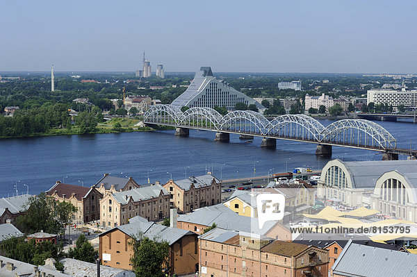 Market halls and the new construction of the new National Library of Latvia on the Daugava River
