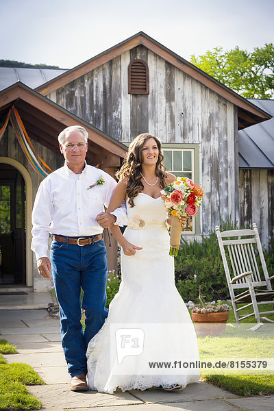 USA  Texas  Father of bride and his daughter at outdoor wedding
