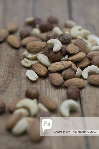 Mixed nuts on wooden board  close up