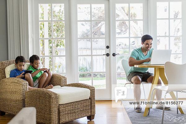Hispanic family relaxing in living room