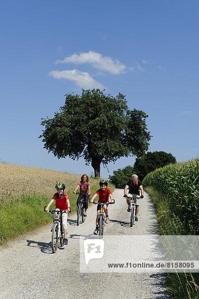 Germany  Bavaria  Cyclist cycling on dirt track