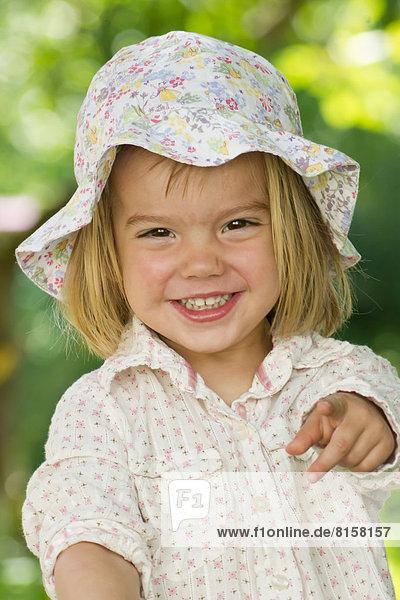 Germany  Baden Wuerttemberg  Portrait of girl in garden  smiling