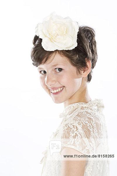 Portrait of girl against white background  smiling