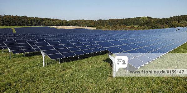 Germany  Bavaria  Solar panels on grass against sky