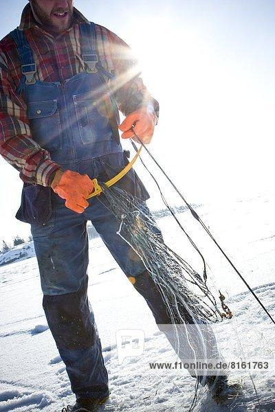 Fisherman holding net