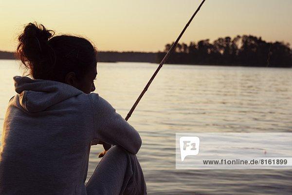 Frau  Abend  angeln  jung