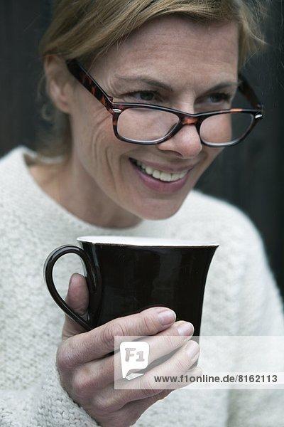 Portrait of mature woman during coffee break