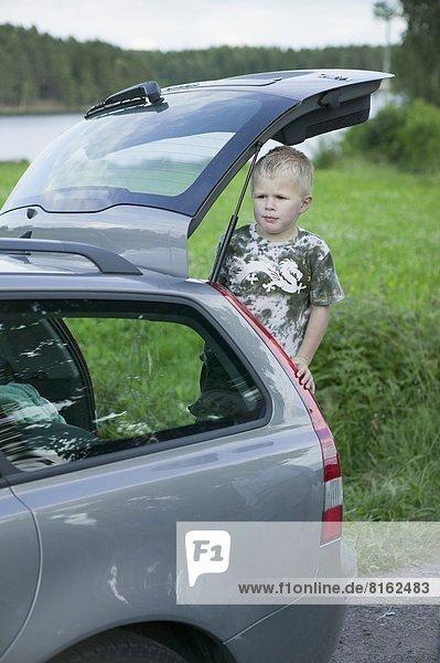 Boy in boot looking away