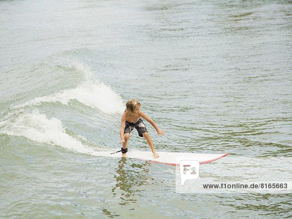 Boy (6-7) surfing