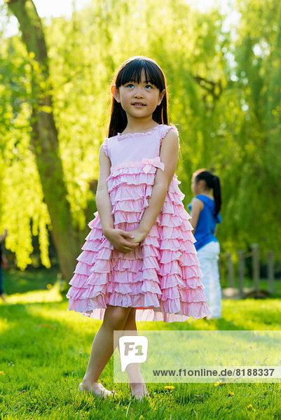 Girl wearing frilly pink dress