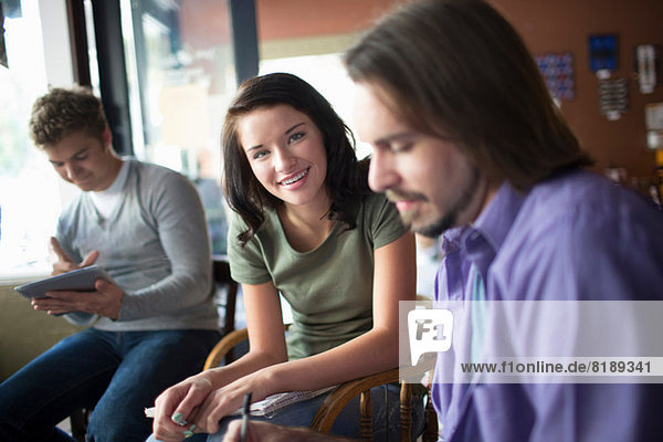 Group of people studying together in coffee shop