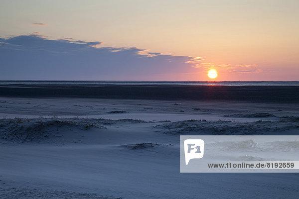 Sonnenuntergang über den Sanddünen am Nordstrand
