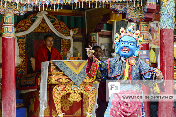 Monk performing ritual mask dance  describing stories from the early days of Buddhism  during Hemis Festival