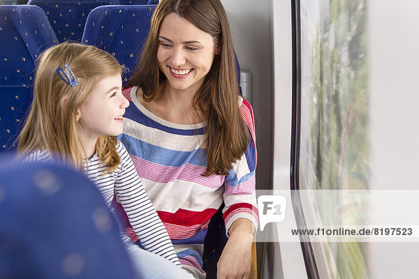 Germany  Brandenburg  Mother with daughter traveling through train