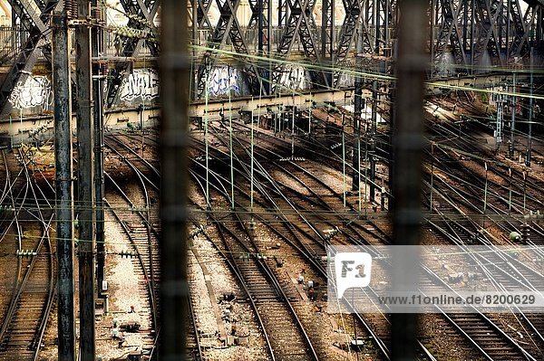 birds eye view of a bridge and train tracks at a station in Paris  France