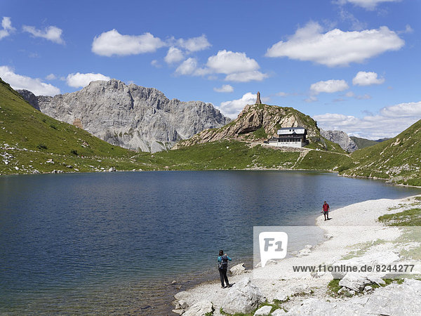 Wolayer Lake or Wolayersee with Wolayersee hut and war memorial