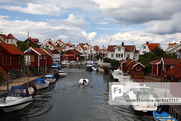 Fishing huts with moored boats
