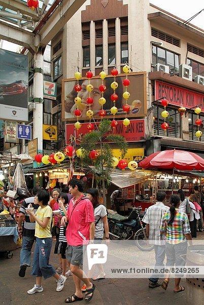 Pedestrian area  shopping  people in Chinatown  Kuala Lumpur  Malaysia