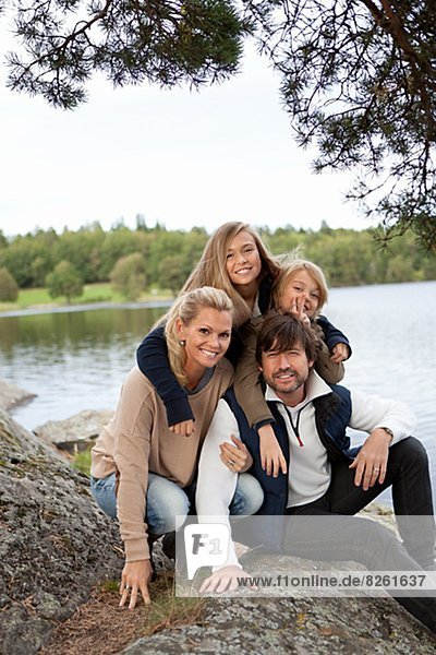 Portrait of family by lake