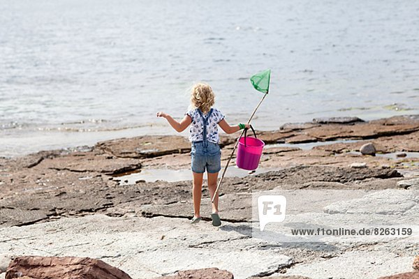 Strand Stange angeln Mädchen