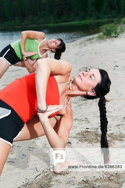 Women doing yoga at beach  Norrbotten  Sweden