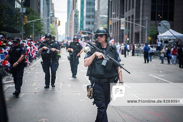 NYPD officers patrol during the Dominican Day Parade in New York on Sixth Avenue
