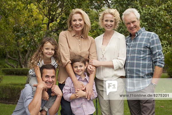 Portrait of multi-generation family smiling outdoors