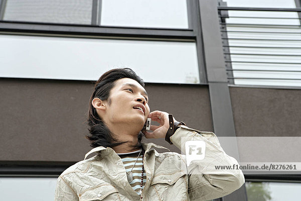 Young man talking on cell phone  portrait