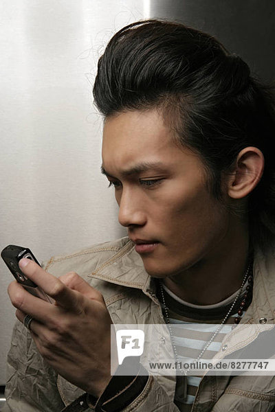 Man holding mobile phone  close-up