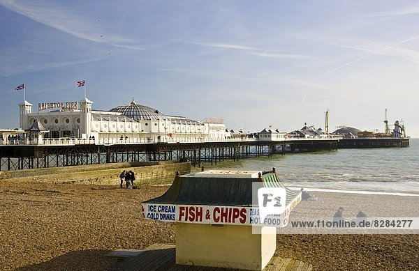 Fish and chip shop on beach by Brighton Pier on the South Coast of England  United Kingdom