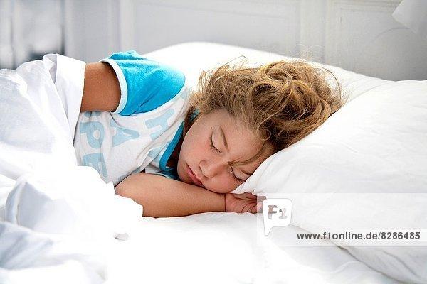 Sleeping girl  white sheets  face down  Ribadesella  Spain