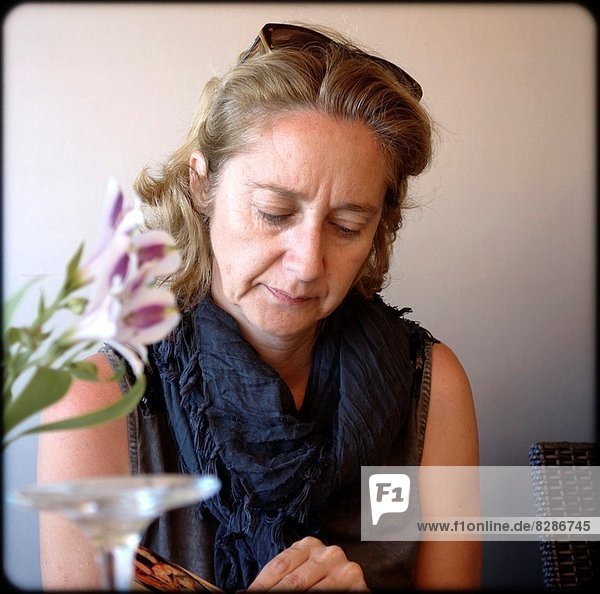 Lady reading in Denia  Spain