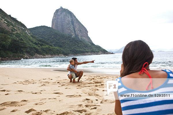 Father and son on beach  Rio de Janeiro  Brazil