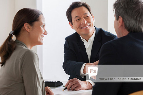 Mature couple meeting businessman