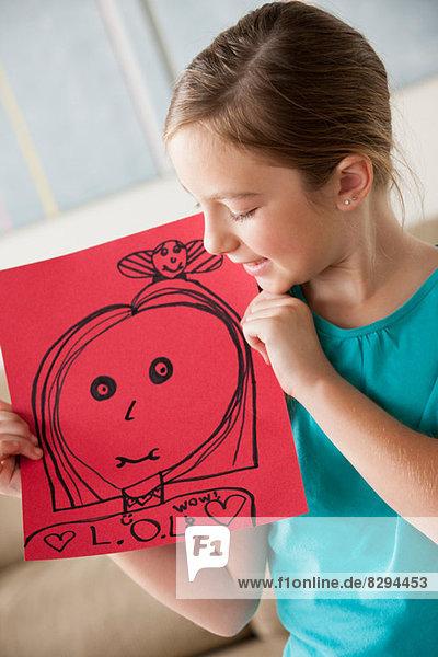 Mädchen mit einer Zeichnung