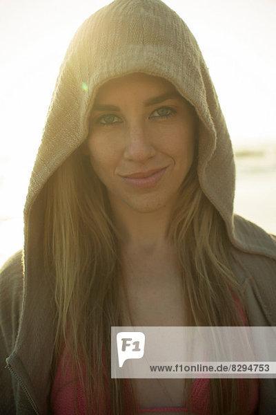 Woman in hoodie looking at camera