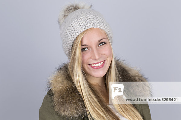 Portrait of young woman with bobble hat
