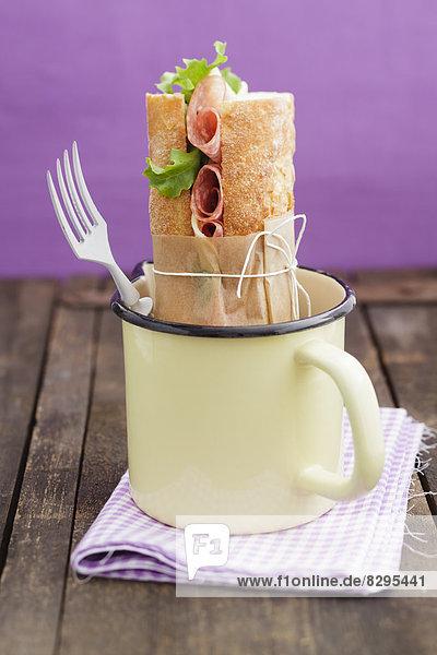 Baguette sandwich garnished in pot