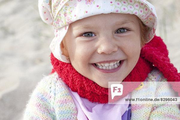 Denmark  Ringkoebing  smiling little girl on the beach