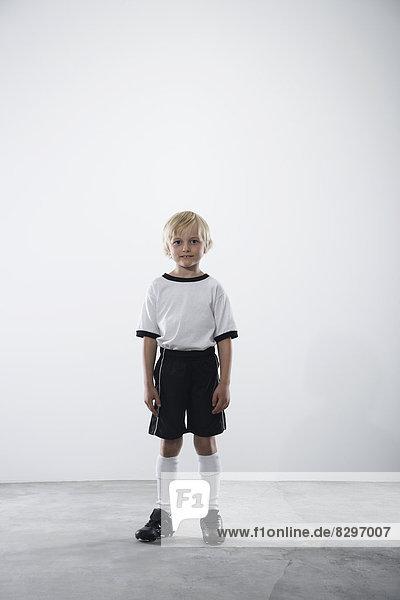 Boy in soccer jersey