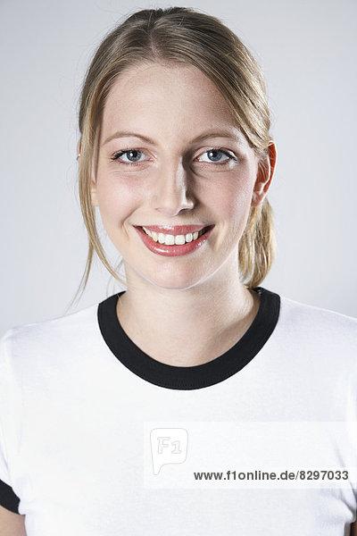 Smiling woman wearing soccer jersey