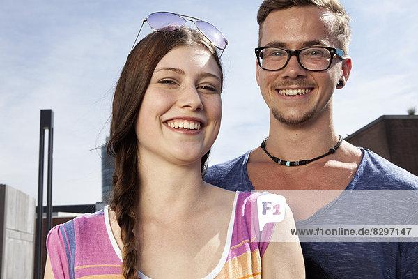 Germany  Bavaria  Munich  Smiling couple outdooors  portrait