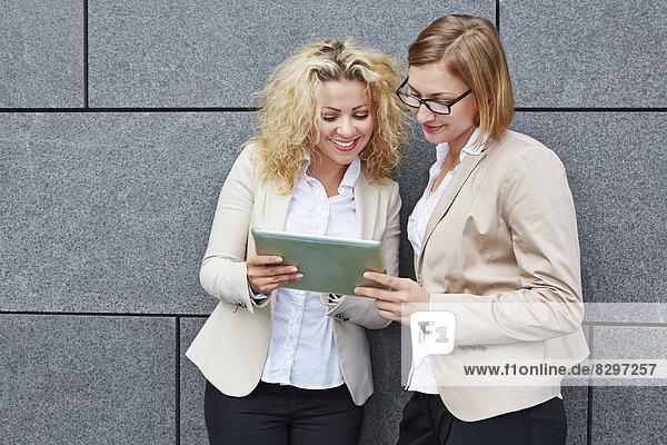 Germany  Businesswomen using digital tablet